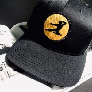 Flying Man Patch Trucker Hat