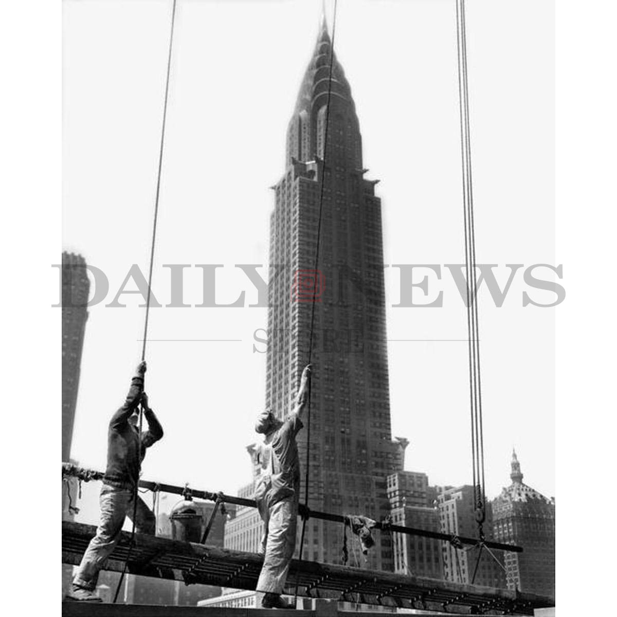 Workers washing the Daily News Building